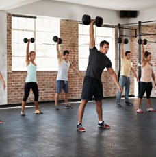 Shot of a group of people lifting dumbbells in a fitness class